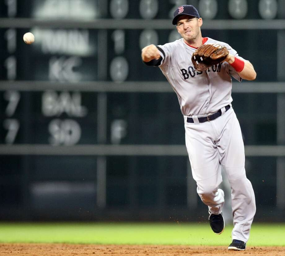 Red Sox shortstop Stephen Drew throws out Astros center fielder Brandon Barnes. Photo: Johnny Hanson, Houston Chronicle