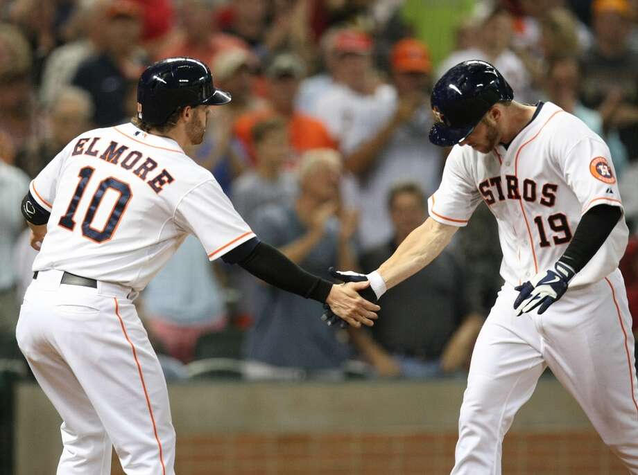 Astros center fielder Robbie Grossman is congratulated by Astros second baseman Jake Elmore after his two-run home run. Photo: Johnny Hanson, Houston Chronicle