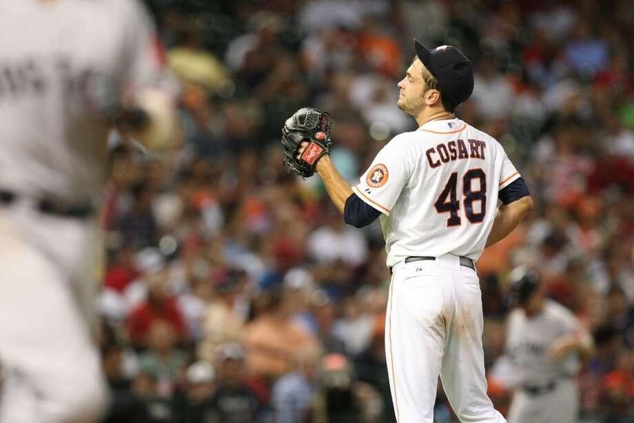 Astros starting pitcher Jarred Cosart walks Red Sox second baseman Dustin Pedroia. Photo: Johnny Hanson, Houston Chronicle