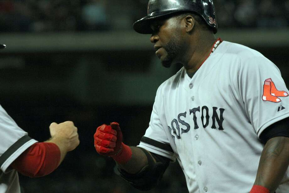 Red Sox designated hitter David Ortiz is congratulated by Red Sox first base coach Arnie Beyeler after getting a hit. Photo: Johnny Hanson, Houston Chronicle