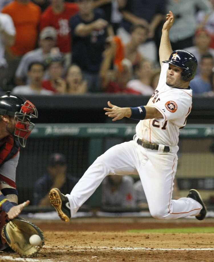 Astros second baseman Jose Altuve slides safely into home past Red Sox catcher Jarrod Saltalamacchia. Photo: Johnny Hanson, Houston Chronicle
