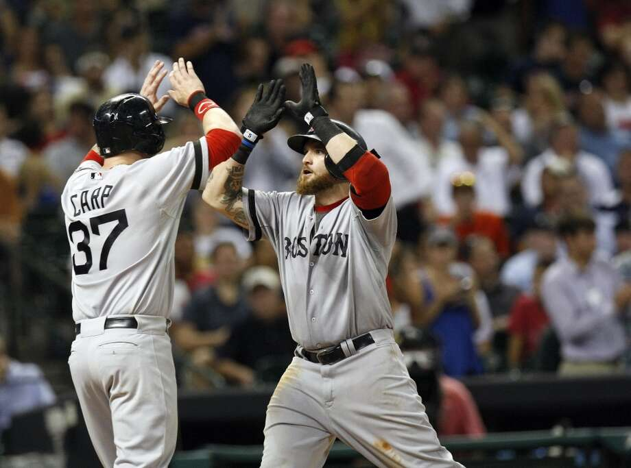 Red Sox left fielder Jonny Gomes is greeted at the plate by Red Sox left fielder Mike Carp after Gomes hit a two-run home run. Photo: Johnny Hanson, Houston Chronicle