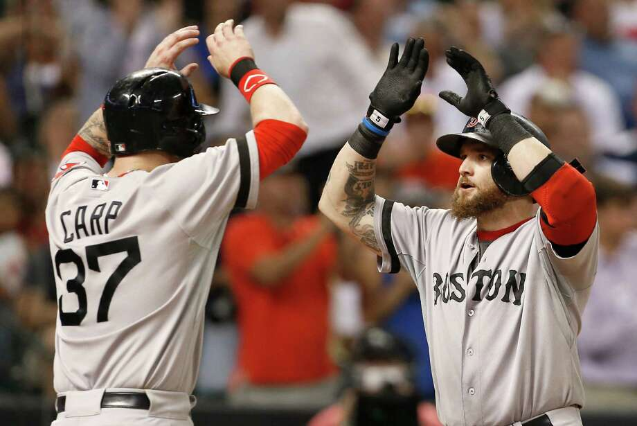 Boston Red Sox's Jonny Gomes, right, is greeted at home plate by teammate Mike Carp (37) after hitting a two-run home run against the Houston Astros in the seventh inning of a baseball game on Wednesday, Aug. 7, 2013, in Houston. (AP Photo/Pat Sullivan) ORG XMIT: HTA117 Photo: Pat Sullivan / AP