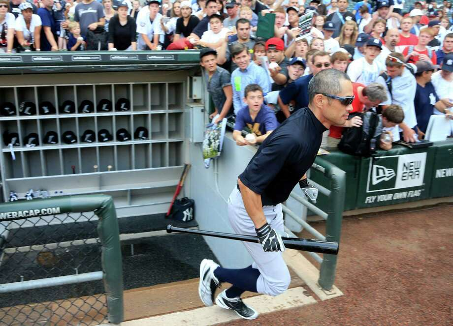 New York Yankees' Ichiro Suzuki heads to a batting cage before a baseball game against the Chicago White Sox, Wednesday, Aug. 7, 2013, in Chicago. (AP Photo/Charles Rex Arbogast) ORG XMIT: CXS105 Photo: Charles Rex Arbogast / AP