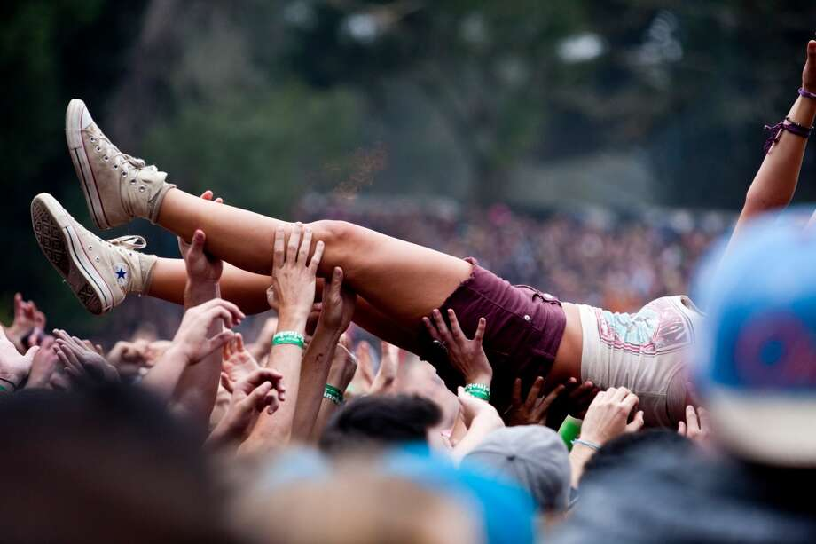 MANNERS. Never wear a skirt when crowd surfing. This should need no further explanation. Photo: Jason Henry, Special To The Chronicle
