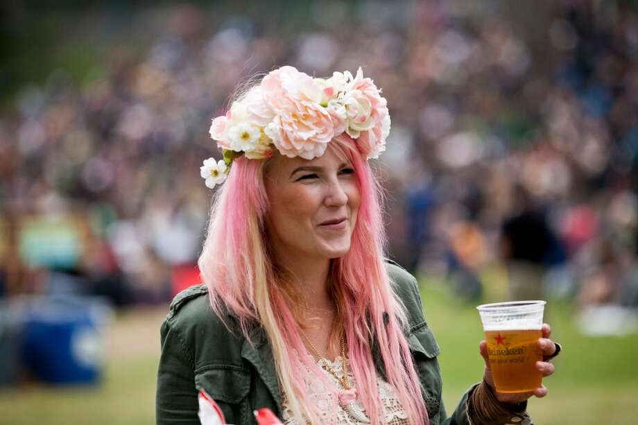 Be sure to wear some (free and compostable) flowers in your hair. GG Park has a plethora of daisies. Give Sir Paul McCartney a nostalgic prop and wear a dainty wreath atop your tresses. Photo: Jason Henry, Special To The Chronicle