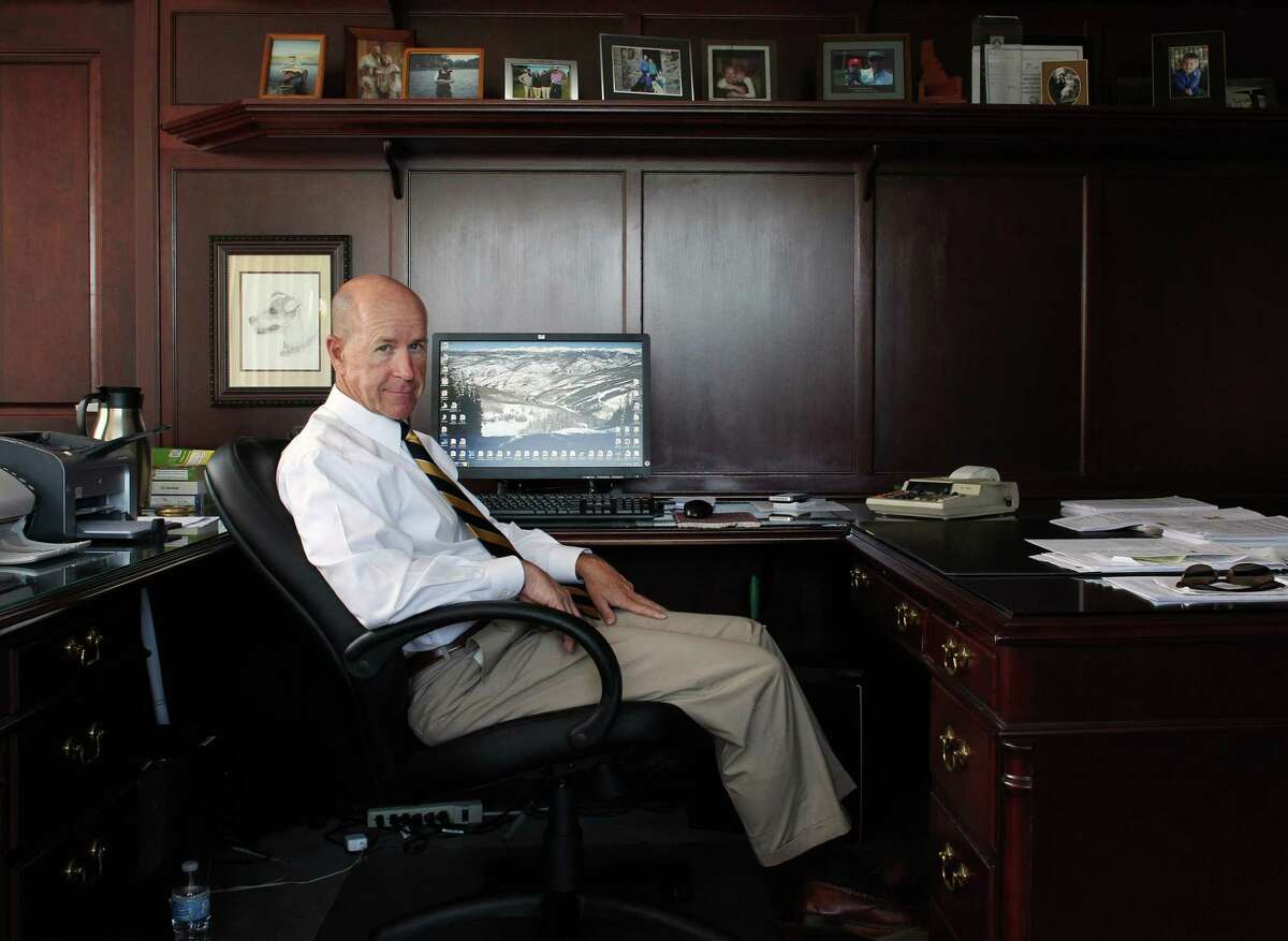 In this July 23, 2013 photo, Mike Shoop, owner of a debt collection agency, sits for a portrait inside his office at Professional Finance Company, in Greeley, Colo. Shoop says his company may have to cut back on coverage for employees if they can't afford insurance under President Obama's new healthcare law.