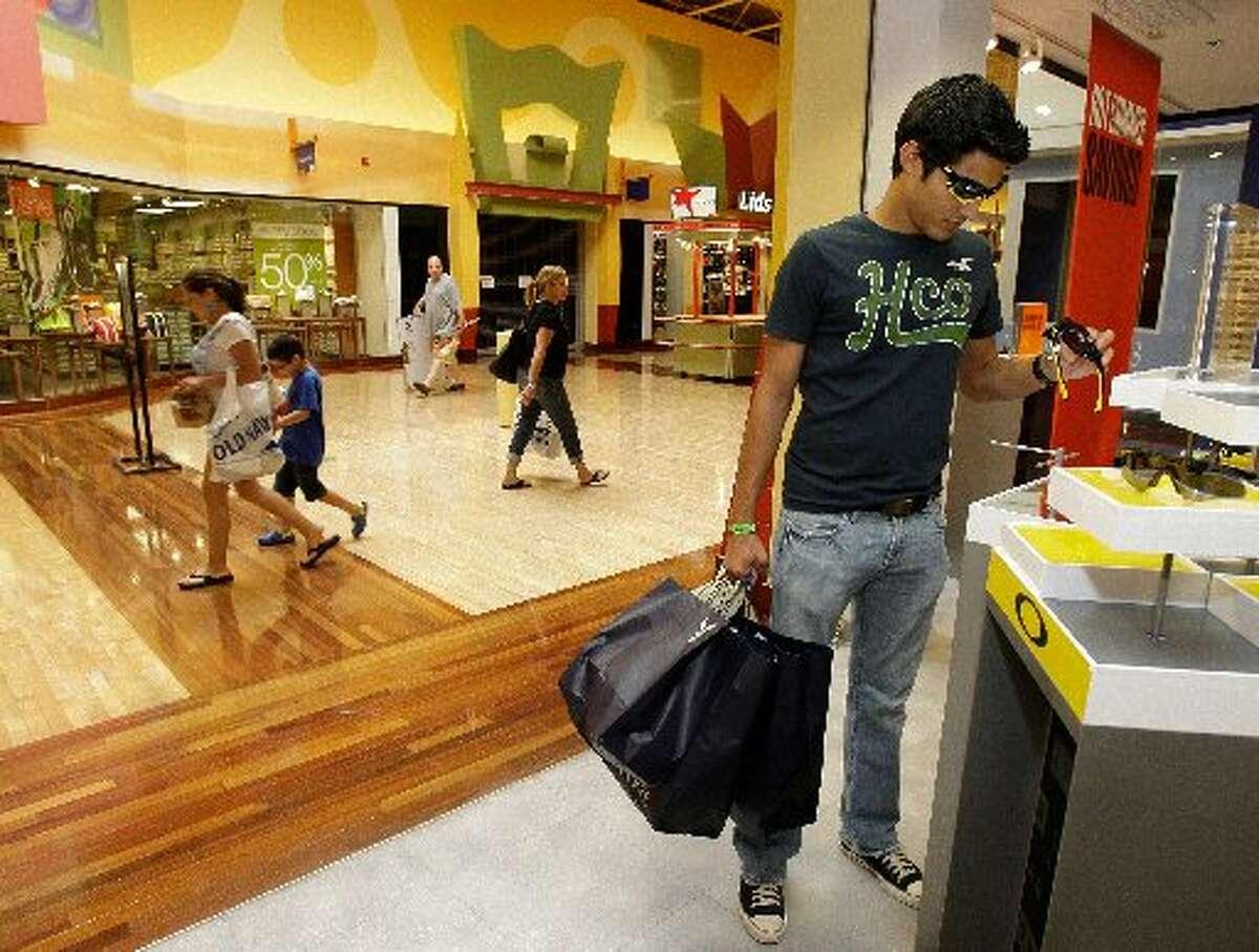 Julio Gonzalez, 18, of Houston shops in Katy Mills mall.