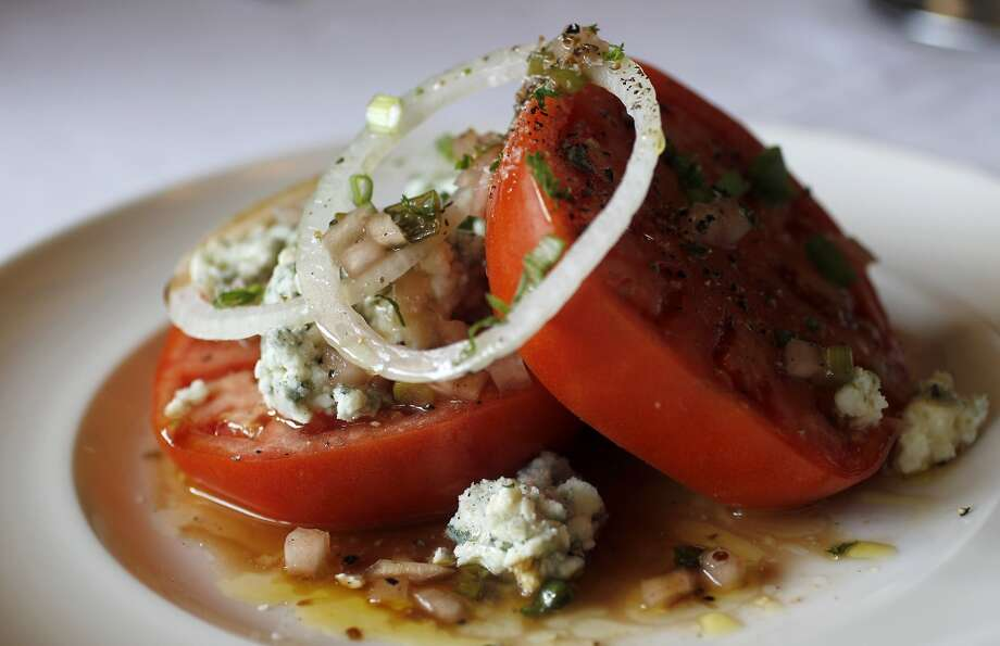 The Beefsteak Tomato and Onions salad with Roquefort cheese at Pappas Bros. Steakhouse Photo: Karen Warren, Houston Chronicle