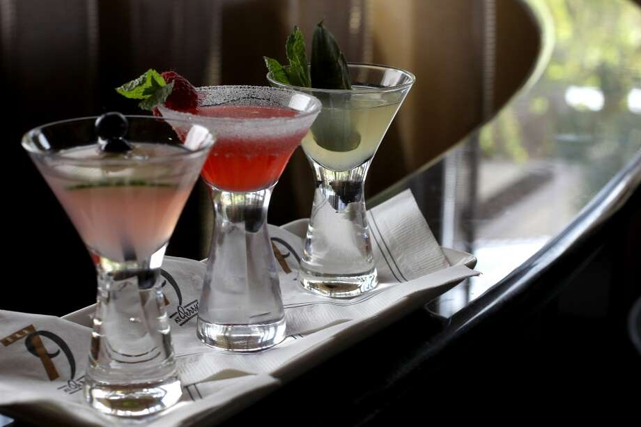 Trio of Martinis: (l-r) Cucumber Blueberry, Raspberry Crusta, and Pineapple Ginger Mojito at Perry's Steakhouse & Grille. Photo: Karen Warren, Houston Chronicle
