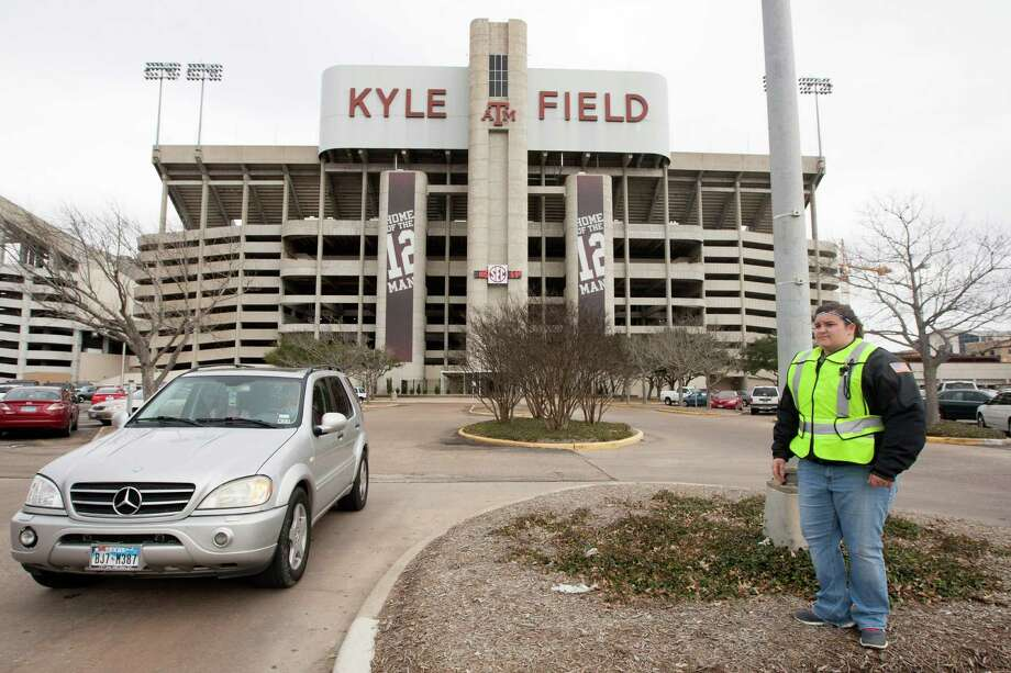 "A Texas A&M security person who wished not to be identified guards the entrance to Kyle Field as a vehicle evacuates the parking lot off after a bomb threat Wednesday Feb. 20, 2013 in College Station, Texas. Texas A&M University is investigating a bomb threat at Kyle Field that prompted the school to issue a ""code maroon"" safety advisory and close the stadium and nearby buildings. (AP Photo/ Patric Schneider) Photo: Patric Schneider, FRE"