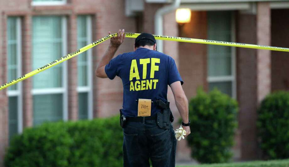 An ATF agent lifts crime scene tape outside the scene of two murders Thursday morning, Aug. 8, 2013, in DeSoto, Texas. Four people were killed at two different locations in South Dallas County and the suspected shooter is in police custody. Photo: LM Otero