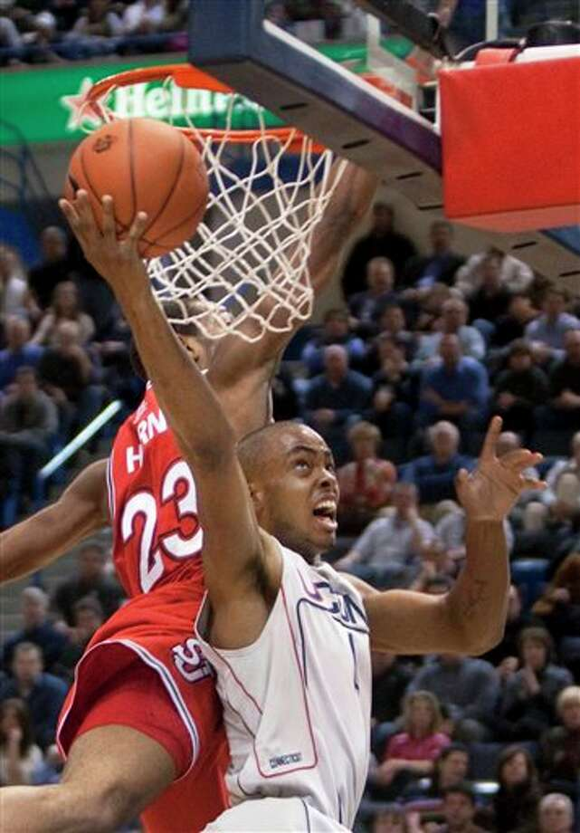 Connecticut's Jamal Coombs-McDaniel, right, shoots around St. John's Paris Horne, left, during the first half of an NCAA college basketball game in Hartford, Conn., on Wednesday, Jan. 20, 2010. (AP Photo/Thomas Cain)