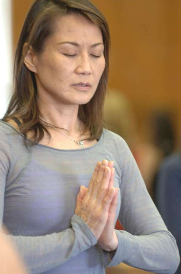 Yuko Ike, from Darien at the Yoga class at the Greenwich Arts/Senior Center, on Wednesday, Jan. 20, 2010. Photo: Helen Neafsey / Greenwich Time