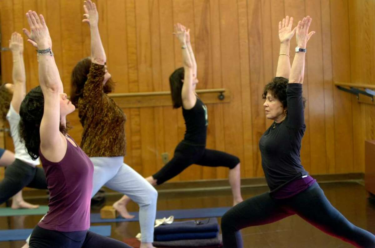 Leslie Manes, at right, teaching one of 2 classes of yoga on Wednesday, January 20, 2010 at the Greenwich Arts/Senior Center.