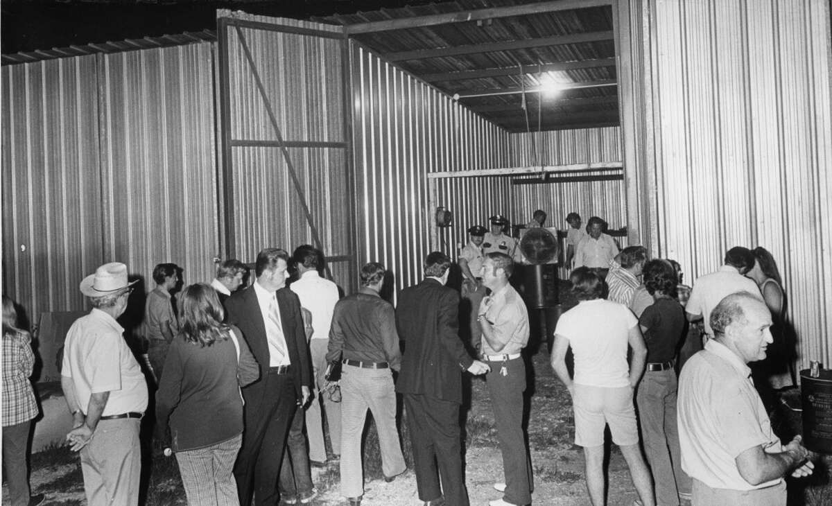 Scene outside boat storage stall in southwest Houston. Published August 9, 1973.