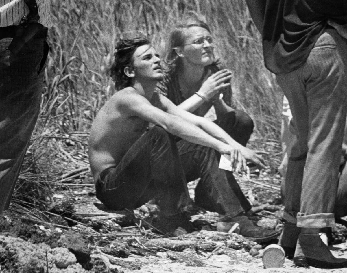 David Owen Brooks, right, and Elmer Wayne Henley take a break after leading authorities to bodies in High Island in 1973.
