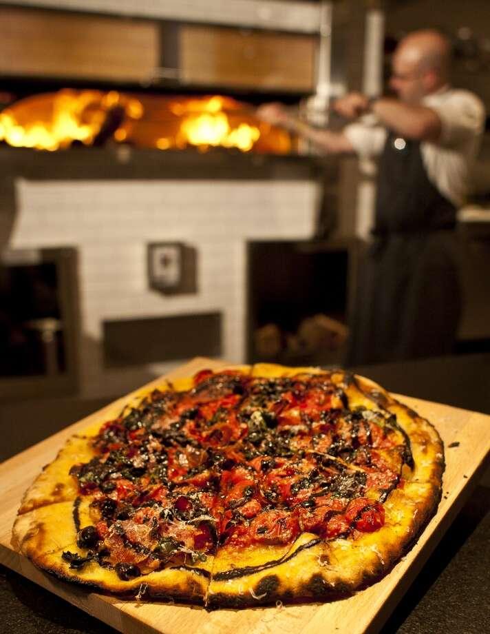 The PassCuisine: AmericanDish: salumi pizza: cured meats with burst tomato, basil and black olive oilEntree price: $$$$Where: 807 TaftPhone: 713-628-9020Website: passandprovisions.com Photo: Nick De La Torre, Houston Chronicle