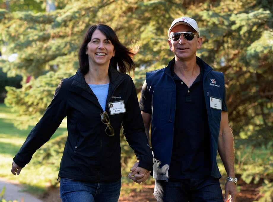 Jeff Bezos, founder and CEO Amazon.com, and his wife Mackenzie Bezos arrives for the Allen & Co., arrives to the Allen & Co. annual conference  July 12, 2013 in Sun Valley, Idaho. (Photo by Kevork Djansezian/Getty Images) Photo: Kevork Djansezian, Getty Images