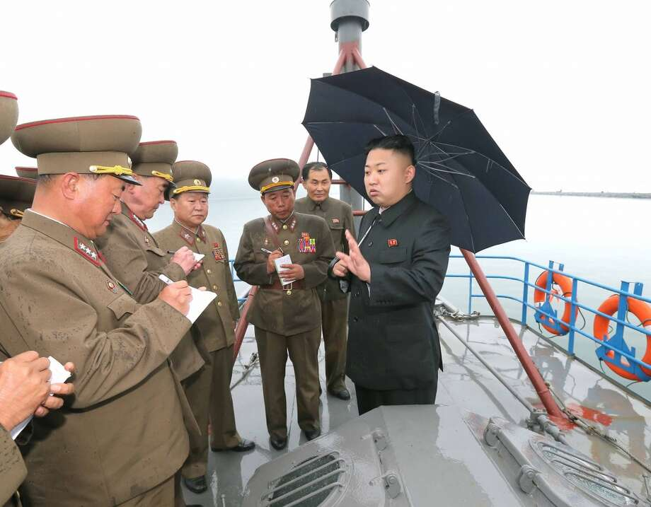 This undated picture released by North Korea's official Korean Central News Agency (KCNA) on May 28, 2013 shows North Korean leader Kim Jong-Un (R) inspecting the August 25 Fishery Station under the Korean People's Army.        (Photo by KCNA/AFP/Getty Images) Photo: AFP, AFP/Getty Images
