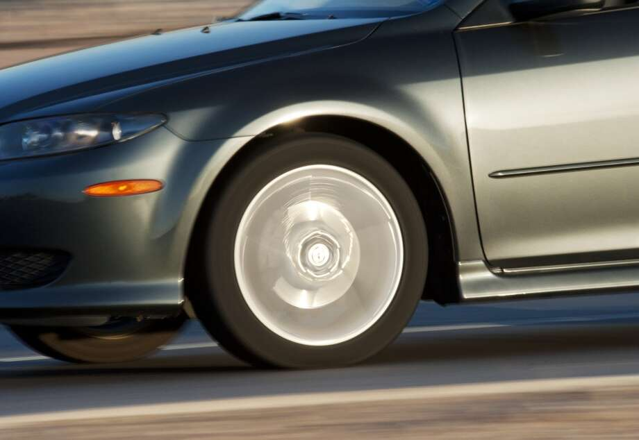 Rear-Tire Slide  Edmunds' Tip: You can't prevent a rear-tire slip, but you can lessen the damage. Once a tire slips, you should steer in the direction of the skid until you regain traction. You'll then need to steer to safety. Photo: Brian Stablyk, Getty Images