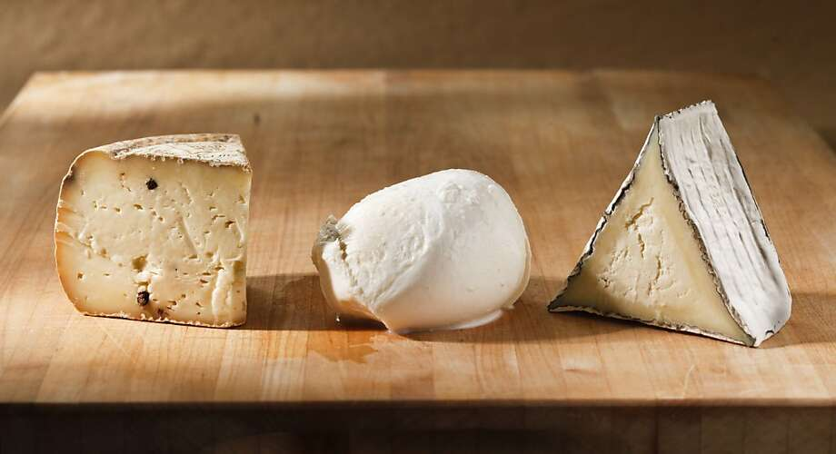 Say cheese! From left: Bellwether Farms Pepato (sheep); Central Point Reyes Fresh Mozzarella (cow); Cypress Grove Bermuda Triangle (goat). Photo: Craig Lee, Special To The Chronicle