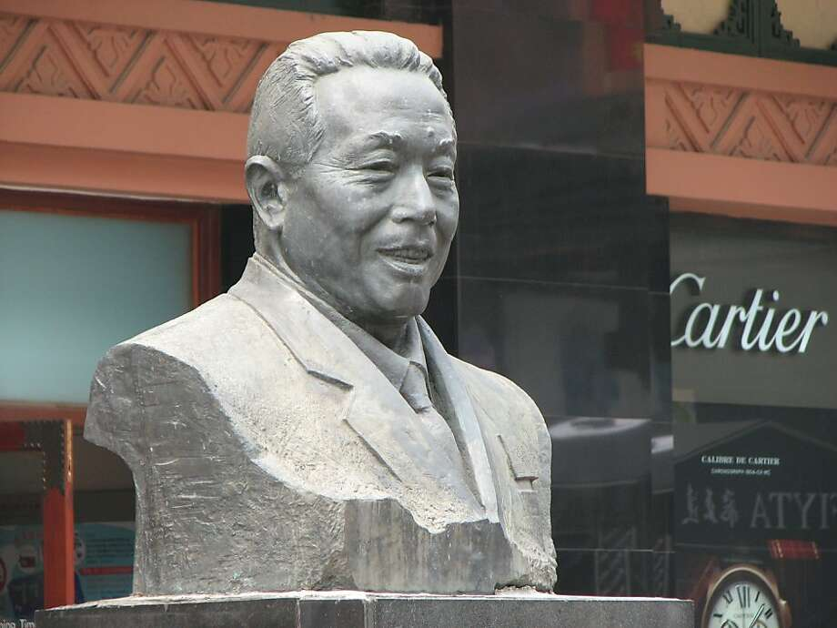 China's socialist past and capitalist future coincide and collide in many ways. This bust of Zhang Binggui sits in a Beijing shopping district of luxury goods. Photo: John Diaz, The Chronicle