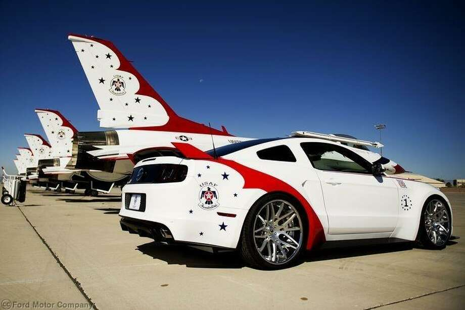 Ford's Air Force Thunderbird Mustang fetched nearly $400,000 at the Experimental Aircraft Association. The money will be donated to the EAA Young Eagles program.