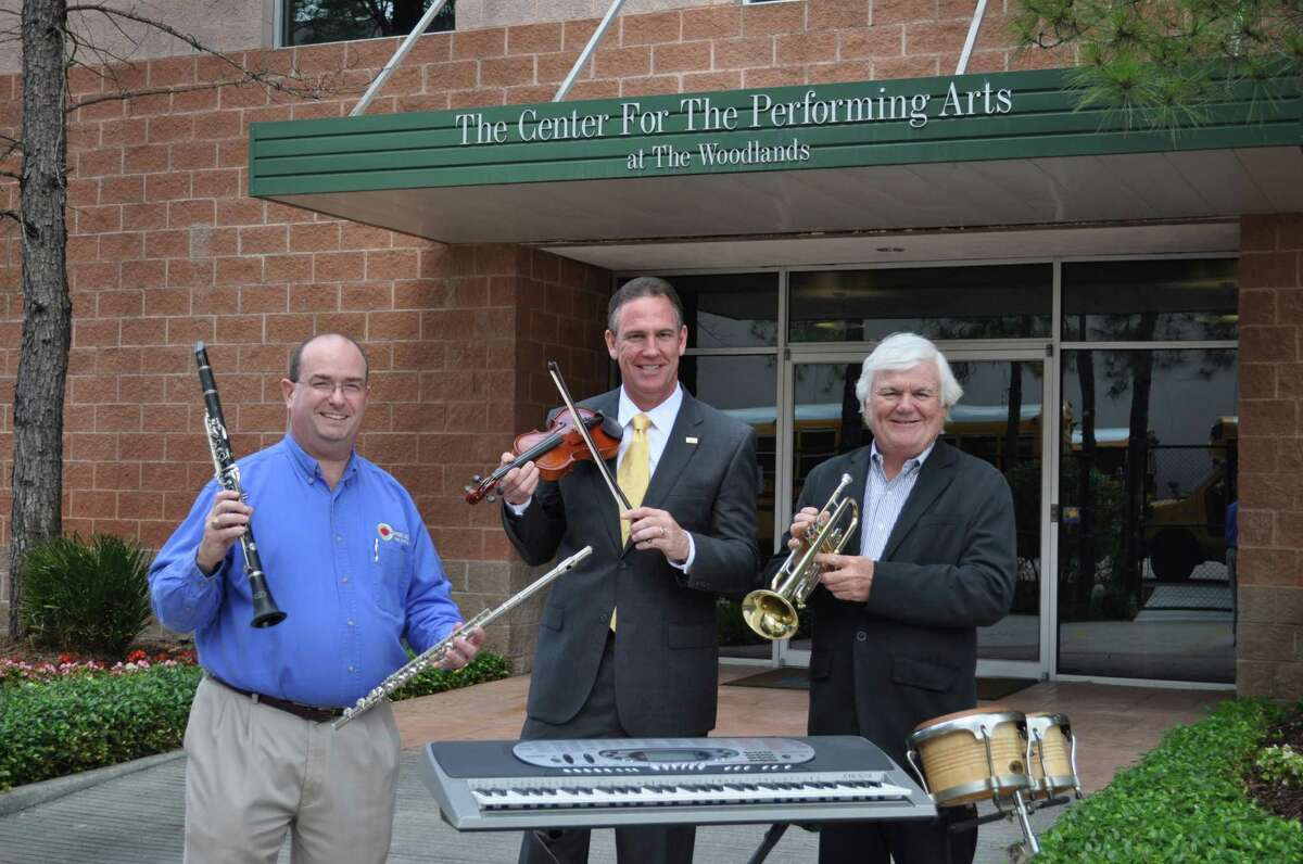 Showing some of the instruments are Pat Paris, left, Conroe ISD's fine arts coordinator; Dr. Don Stockton, Conroe ISD's superintendent; and Jerry MacDonald, the Pavilion's president and CEO.