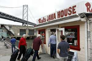 Lunch-goers enter Red's Java House on the bay in San Francisco, Calif. on July 16, 2013.