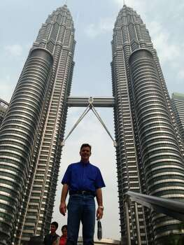 Photo was taken in Kuala Lumpur Malaysia. There buildings are the Petronas Towers.