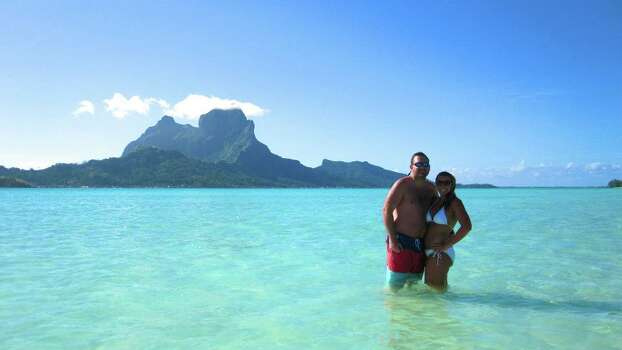 We were recently married on March 2, 2013 and this photo was taken on our fantastic honeymoon to Bora Bora. On our two week adventure we had the opportunity to explore the islands of Tahiti, Bora Bora and Moorea.  The view was breathtaking, but the color of the water was ridiculous.  We love any vacation that involves sand and sun, but this one was truly once in a lifetime.