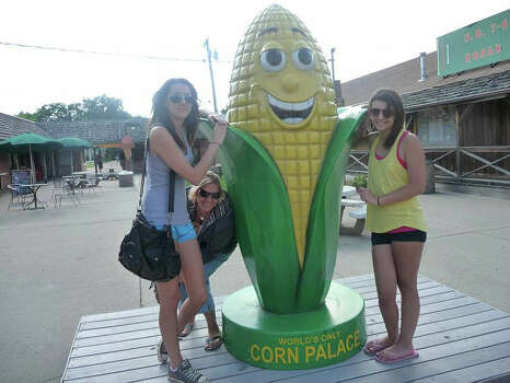 Just what the kids wanted to do with their summer vacation, go to Mitchell, South Dakota to see the World's ONLY Corn Palace and pose with a giant corn on the cob. Thanks, mom.