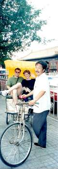 "A trip of a lifetime with my son Donald E. Hopkins in the year 2000, just before our world changed forever.  This was taken in the ancient alleyways of Beijing called the hutong.  modern ""progress"" threatens their survival with hotels and apartments.