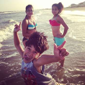 Photobombed by little brother!  We were on vacation at Crystal Beach in Port Bolivar, TX.