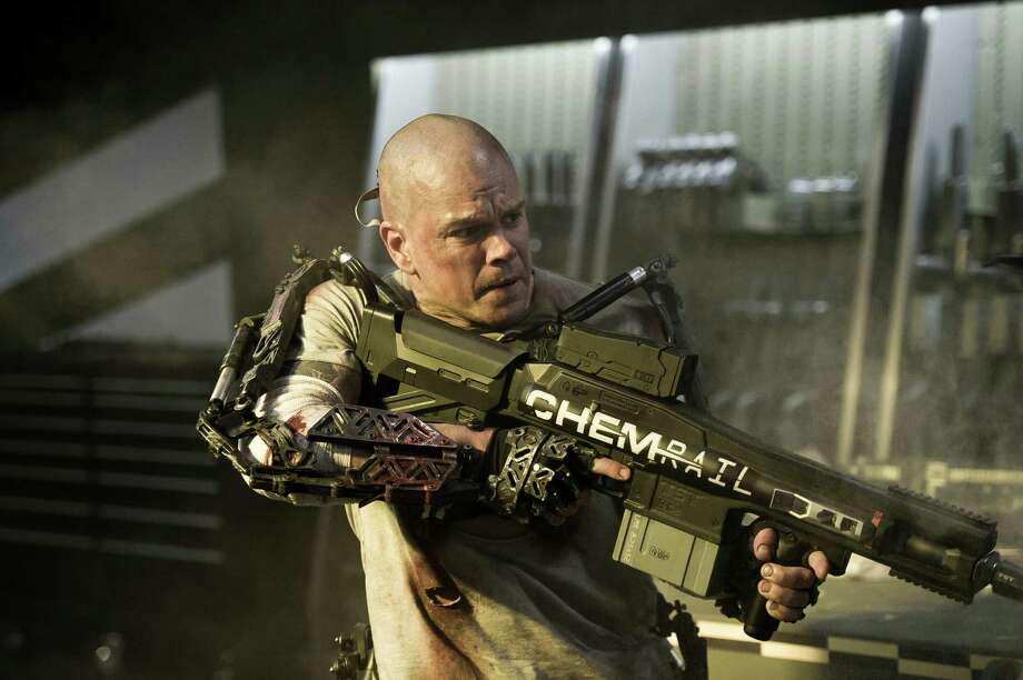 """This film publicity image released by TriStar, Columbia Pictures-Sony shows Matt Damon in a scene from """"Elysium."""" (AP Photo/TriStar, Columbia Pictures - Sony, Kimberley French) ORG XMIT: NYET849 Photo: Kimberley French / TriStar, Columbia Pictures-Sony"""