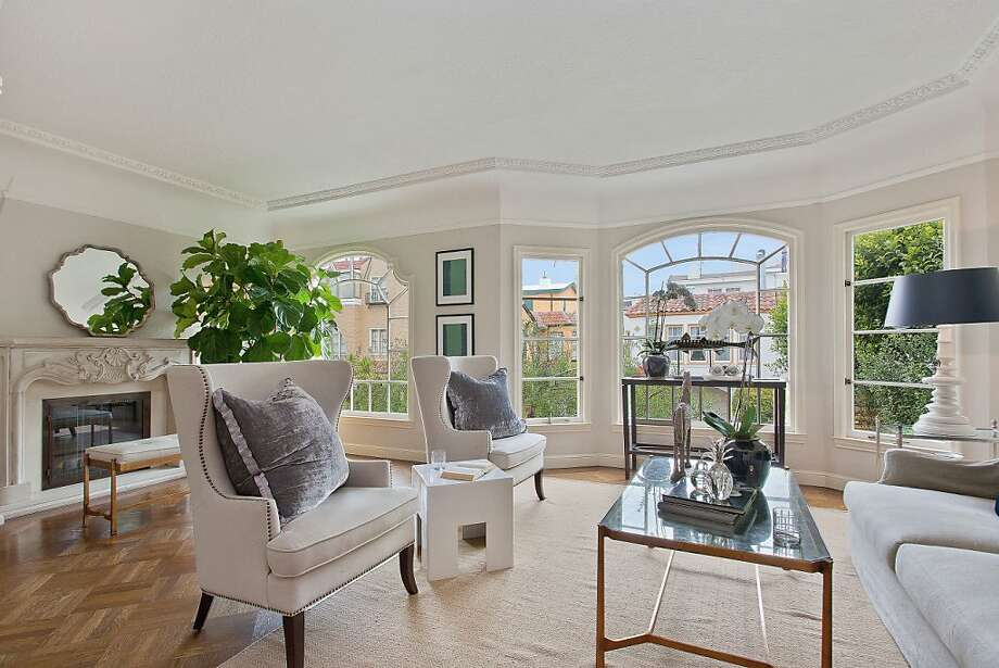 The living room of 75 Rico Way in San Francisco's Marina District includes windows from the home's original 1931 construction. Photo: OpenHomesPhotography.com