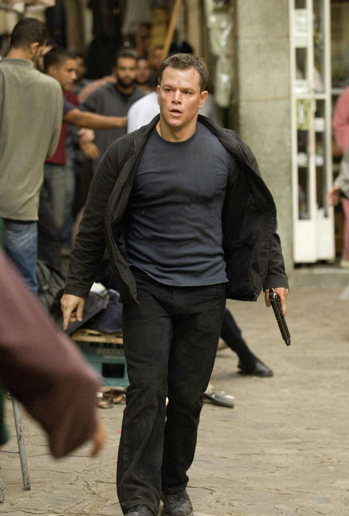 """** FILE ** In this image originally released by Universal Pictures, Matt Damon is shown as the character Jason Bourne in """"The Bourne Ultimatum."""" One of the Museum of Modern Art's latest film acquisitions isn't an art-house experiment by the likes of Andy Warhol or Michelangelo Antonioni. It's the spy-action blockbuster """"The Bourne Identity"""" and its sequels. This week the museum is screening the films and hosting a panel discussion with """"Bourne"""" director/producer Doug Liman and a noted neuroscientist to talk about memory, identity and the mysterious workings of the brain. (AP Photo/Universal Pictures, Jasin Boland, file) ** NO SALES **"""
