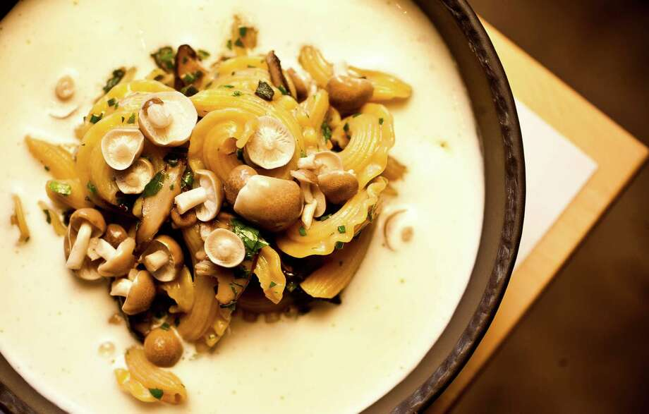 The Pass & Provisions'pasta with hen of the woods mushrooms over Parmesan foam. Photo: Nick De La Torre, Staff / © 2012 Houston Chronicle
