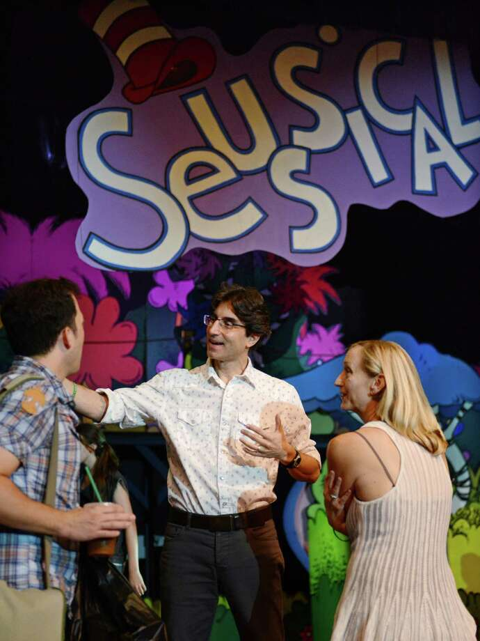 Actor John Tartaglia, left, is welcomed to the set by director Michael Unger and choreographer Jennifer Paulson Lee during a dress rehearsal of Seussical at Newtown High School in Newtown, Conn. on Thursday, August 8, 2013.  The performance, presented by the 1214 Foundation, features Broadway actor John Tartaglia and over 80 students from the Newtown area.  Shows will be Friday, Aug. 9 at 7 p.m., Saturday at 2 p.m. and 7 p.m., and Sunday at 2 p.m. Photo: Tyler Sizemore / The News-Times