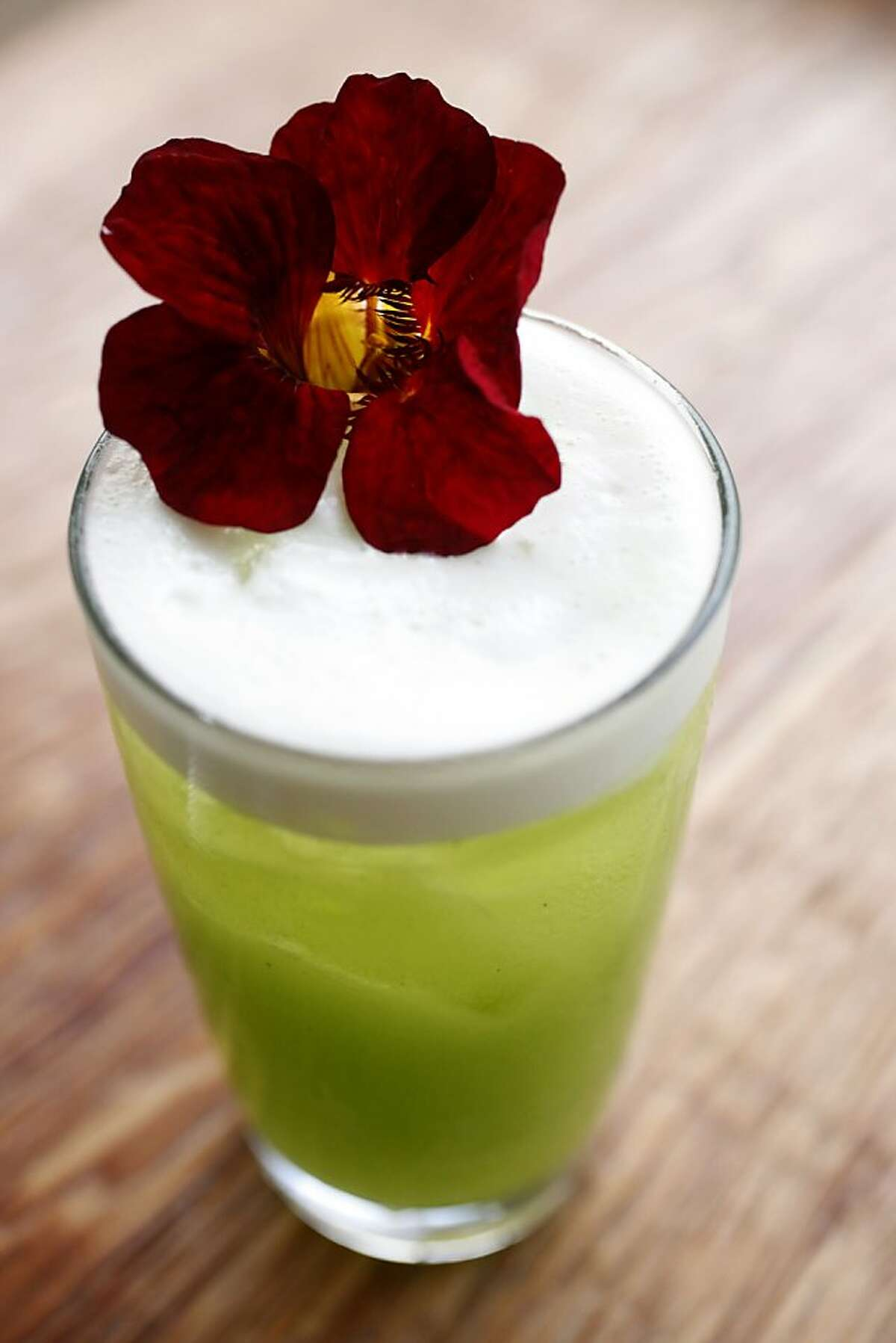The 'Big Night II' signature cocktail garnished with a nasturtium as seen at Rich Table in San Francisco, Calif. on August 7, 2013.