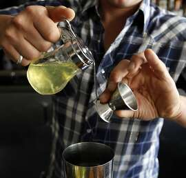Buffalo LoGrasso, Rich Table bar manager, mixes ingredients for his 'Big Night II' signature cocktail at the Hayes Valley restaurant in San Francisco, Calif. on August 7, 2013.