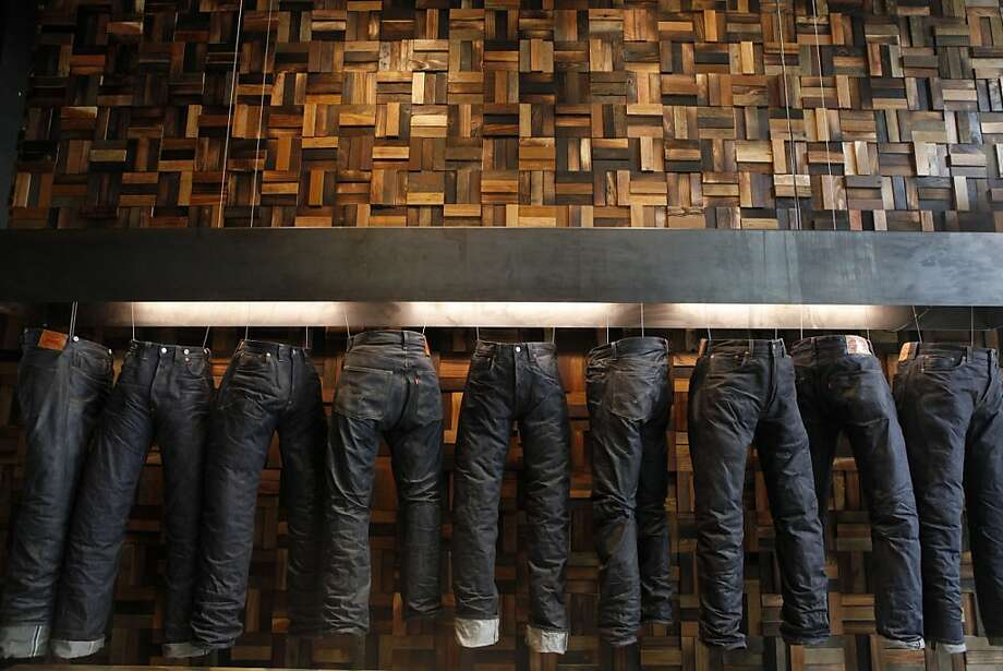 A sneak peak into the new Levi's store that is opening its 7,000-square-foot space tomorrow at Market and 4th streets as seen on July 31, 2013 in San Francisco, Calif. All of the art inside the new space, including this wooden wall, were designed by local artist in San Francisco. Photo: Katie Meek, The Chronicle