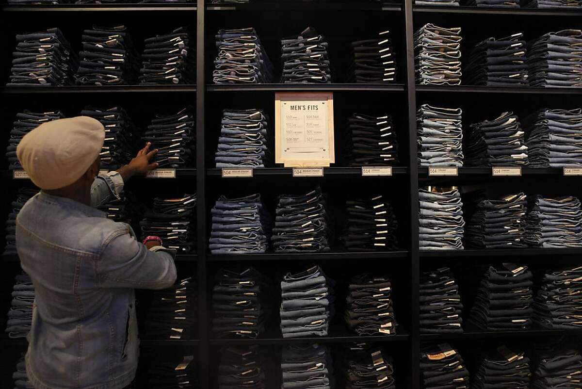 Camron Ferguson searches for the correct size and style of jeans for a customer during a sneak peak event at the new Levi's store which will be opening its 7,000-square-foot space tomorrow at Market and 4th streets as seen on July 31, 2013 in San Francisco, Calif.