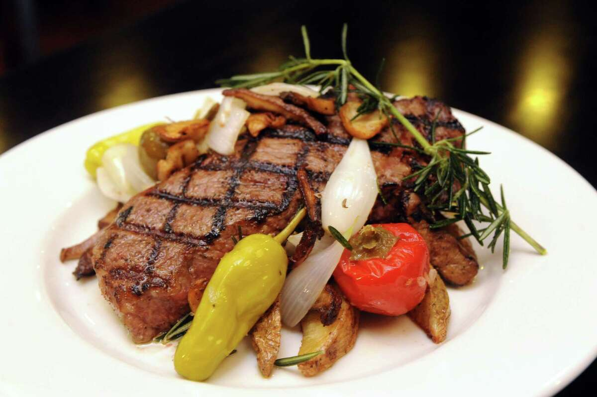 Steak Amalfi at Johnny's restaurant Thursday, Aug. 1, 2013, in Schenectady, N.Y. (Michael P. Farrell/Times Union)