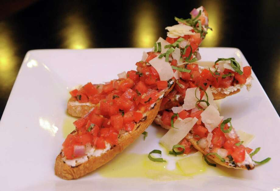 Johnny's Italian-American Restaurant. 433 State St., Schenectady.Tomato bruschetta at Johnny's restaurant Thursday, Aug. 1, 2013, in Schenectady, N.Y. (Michael P. Farrell/Times Union) Photo: Michael P. Farrell / 10023363A