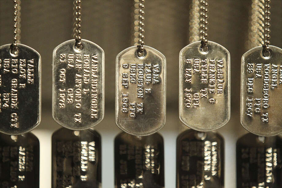 "The Institute of Texan Cultures has on display ""Texas Vietnam Heroes."" Military ID tags, also called ""dog tags,"" are the featured exhibit. According to the exhibit, 3,417 Texans never returned from the conflict. Photo: Kin Man Hui, San Antonio Express-News"