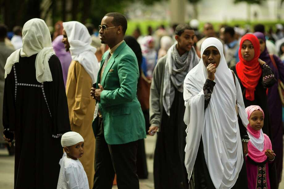 Families gather outside of the exhibition hall following a Eid-ul-Fitr community prayer service Thursday , August 8, 2013, at the Seattle Center in Seattle. The holiday celebrated by Muslims worldwide marks the end of Ramadan, the Islamic holy month of fasting. Photo: JORDAN STEAD, SEATTLEPI.COM / SEATTLEPI.COM