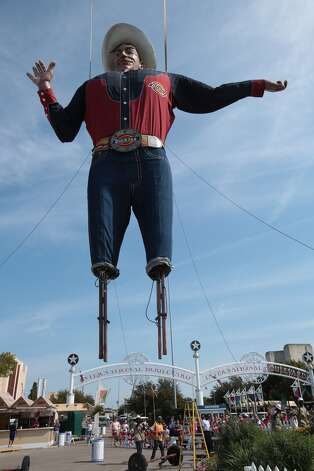 Workers raise Big Tex for his 60th time for the Texas State Fair at Fair Park in Dallas September 24, 2012. (Nathan Hunsinger/ The Dallas Morning News)