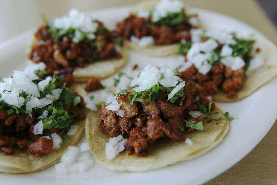 At Los Roberto's, spicy pork and fresh and near-caramelized onions in the tacos al pastor hint of Mexican interior flavors.